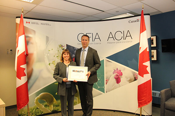 Paul Glover, the President of the CFIA and Heather Gale, Executive Director of CanadaGAPs