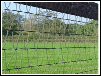 A picture of a metal mesh horse fence.