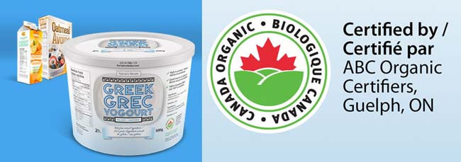 A 500 grams container of Greek yogourt at the front with a carton of orange juice and a box of oatmeal cereal in the far back left corner. To the right is a closer view of the Canada organic logo and a statement identifying the certification body on the Greek yogourt label.