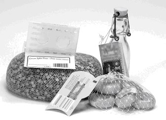 ornamental bottle, waxed-encased small cheeses and foil-wrapped milk chocolate in a mesh bag