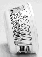 Margarine container with tapered Nutrition Facts table. The on its side NFT narrows towards the bottom of the container to follow its shape. This is not permitted.